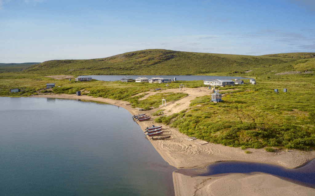 Lodge located on the shores of Point Lake in Canada's Northwest Territories, barrens, boats lined up on sand beach